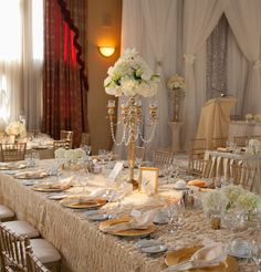 what a cool table setting! love the tall centerpieces and the cream-and-gold.  this would look beautiful even with just plain white linens