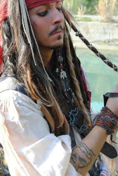 Capn.Jack Sparrow cosplay. This pleases me they even went as far as to copy the sparrow tattoo and x on his cheek. Very detailed.