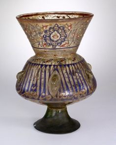 Mosque-lamp. With depressed base. Made of brown and gilded and polychrome enamelled glass (bubbly).