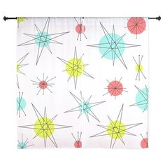 Atomic Era Art Curtains. A cool vintage styled mid century pattern with black lines and red, light blue and yellow circles. A great addition to any living room or bedroom.