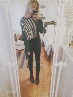 Black & white striped tee , black skinny jeans , ankle boots , green cardigan