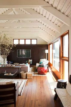 TV wall + decor in Hamptons home by David Giles Photography