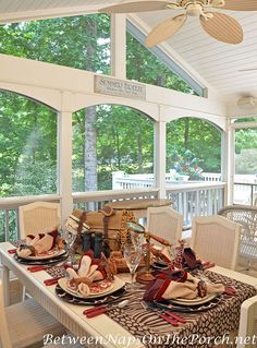 Safari Table Setting with Giraffe Chargers & Giraffe Glasses from Between Naps on the Porch.