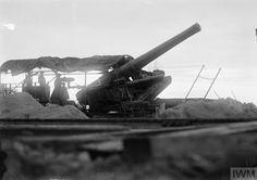 WWI, 22 August 1917; 9.2 inch railway gun of the Royal Garrison Artillery ready to fire at night, near Boezinge. ©IWM Q 2766