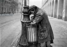 1941, Warsaw, Poland. A man searching through the trash. The photo is from Air General Hellmuth Bienecka's album.