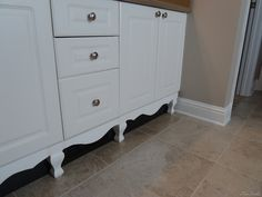 How to add legs and a skirt trim to make builder grade cabinetry look like furniture