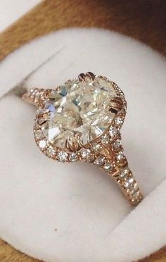 Rose Gold Oval Shaped Diamond Ring. This is a little over the top for me to wear, but so beautiful!