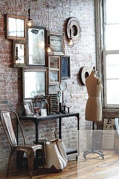 Brick wall with vintage frames and metal table.