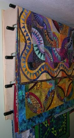 Really cool idea to store quilts, table cloths and blankets - opens up a TON of space in the closet. Hang'n It, quilt hanger and storage.