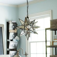 """Moravian Star Pendant  ballard design Overall: 19 1/2""""H X 19"""" Diameter Ceiling Canopy: 5"""" Diameter Chain: 6'L Construction: Made of iron, brass and glass. Lighting: Uses type A 60W max bulb. Cord is 6'L and black. Country of Origin: India"""