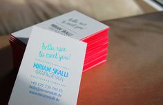 business cards printed with holographic foil stamping and bright neon coral edges