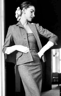 Sherry Nelms is wearing a dress with matching jacket by Mollie Parnis, 1951