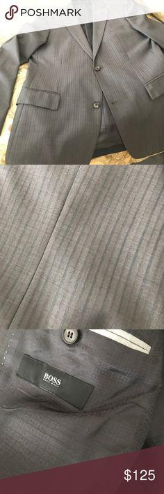 Hugo boss grey stripe suit jacket 42 r Hugo boss grey stripe suit jacket 42 r.  Purchased at Nordstrom.  Very nice double vent, with a subtle stripe pattern. Boss Black Suits & Blazers Sport Coats & Blazers