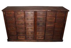 General hardware store wood cabinet with 36 drawers in a medium brown finish. Vintage: 1910-1950 in very good condition.