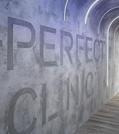 Imitation of concrete with the Perfect clinic writing and further on enhanced with vertical led stripes — Němec s.r.o.