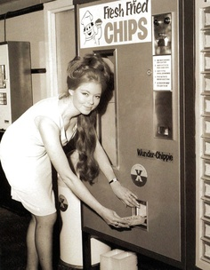 Model Susan Gregg using a new chip vending machine at the Bedford Court Hotel, which serves a fresh portion of chips every 45 seconds at a cost of one shilling (10 pence) - 4 December 1967