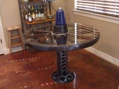 All tables and accessories are made from authentic early American wagon wheels and wagon parts. Horse shoes incorporated with blacksmith art.