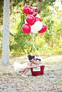 Valentine Day photo shoot. for small children. have siblings hold balloons. could also do a train track shoot b/w with red and white balloons