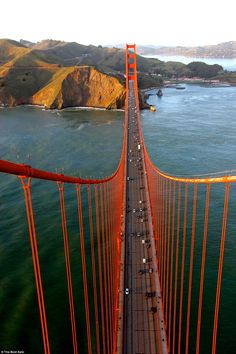 A daredevil photographer has taken a set of spectacular yet stomach-dropping pictures from the dizzy heights of the Golden Gate Bridge