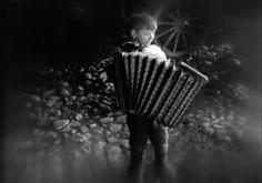 Jongen met accordeon