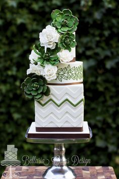 Everything that a traditional wedding cake isn't supposed to be, but everything a cake needs to look fantastic. What one would normally use to decorate, you don't see on this cake. Here the green flowers are the centre of attention. One look at this cake and you're thinking of an afternoon when you're sitting outside and soaking up the sun while the green leaves are rustling in the wind. The succulent and chevron take traditional to another level and the dark green, ...