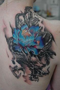 lotus and dragon tattoo | ... tattoo of black dragon with big blue lotus flower - Dragon tattoos