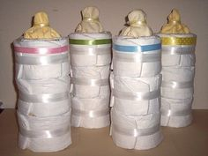 Pack 'em and stack 'em! Top a three evenly tiered diaper cake with a washcloth to create a a baby bottle