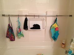 tension rod + shower curtain hooks + .50 basket=the best way ever to store wet swimsuits & swimming gear!  This made this swim mom's life so much easier!  might be the best idea i've ever had.