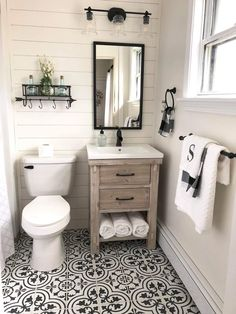 Farmhouse style bathroom with shiplap walls, ceramic tile flooring, wood vanity, and neutral decor. Small Bathroom Ideas, Small Bathroom Remodeling, Basement Bathroom Ideas, Bathroom Remodel Small, Small Full Bathroom, Half Bath Remodel, Small Sink, Simple Bathroom, Upstairs Bathrooms