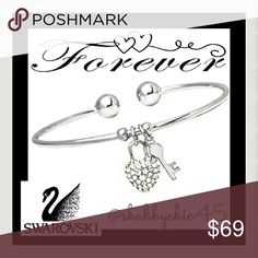 """Silvertone Key to my Swarovski Heart Arm Cuff Let your sweetheart know how important they are to you with this beautifully crafted Key to my Heart Bracelet designed by Barzel Jewelry. Heart is adorned  with Swarovski clear crystals. Bracelet is approximately 7"""" in diameter and is made of rhodium-plated brass.  PRICE IS FIRM. NO OFFERS ACCEPTED.  💘Smoke free home. Open to reasonable offers unless marked as firm. Please no trades or low balls. Happy Poshing!!💘 Swarovski Jewelry Bracelets"""