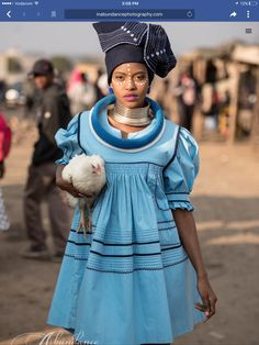 with the chicken as an accessory 🤗👍🤣 . Sepedi Traditional Dresses, South African Traditional Dresses, Traditional Fashion, Xhosa Attire, African Attire, African Wear, African Print Dresses, African Fashion Dresses, African Dress