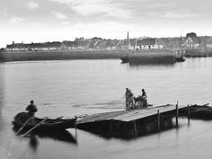 Claddagh fishermen casting nets. Rows of the fishermen's thatched cottages prior to modernisation can be seen in the background