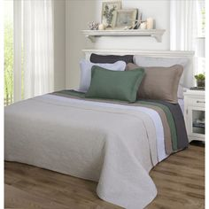 @Overstock - Corrington 100-percent Cotton 3-piece Quilt Set - Bring a rustic feel to your bedroom with this 100-percent cotton quilt and pillow sham set. The set is designed with a floral checkered pattern, giving it the beautiful and timeless look of a classic quilt.  http://www.overstock.com/Bedding-Bath/Corrington-100-percent-Cotton-3-piece-Quilt-Set/9408205/product.html?CID=214117 $84.99