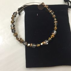 Alex and Ani bead Beaded bangle from holiday 15 collection. Discontinued and beautiful! On gold wire. PRICE IS FIRM Alex & Ani Jewelry Bracelets
