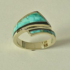 14 karat yellow gold mens ring with natural stone inlay of Turquoise from the Candalaria mine and Jet .