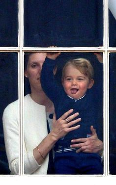 13th June 2015, Prince George at the window of Buckingham Palace with nanny Maria Teresa Turrion Borrallo on the day of the Trooping the Colour ceremony.