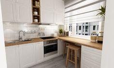Aranżacja białej kuchni z drewnem