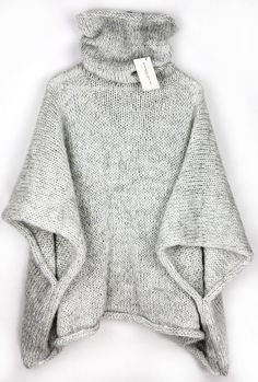 Cuddly knitted poncho for winter with a high collar / knitted cape for . Cuddly knitted poncho for winter with a high collar / knitted cape for the winter season, knitwear made by Alexandra Mil. Poncho Pullover, Poncho Sweater, Poncho Outfit, Baby Cardigan, Diy Tricot Crochet, Pull Poncho, Warm Sweaters, Knitting Sweaters, Oversized Sweaters