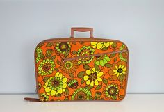 Vintage suitcase with large retro flowers in bright orange, yellow and green! This is a great medium sized piece of luggage -perfect as an overnight bag or for a long weekend. Flower portion is fabric & the brown portion is a leatherette type material, made in Japan. There is a large zipper pocket on exterior and a pocket on interior. Condition: great vintage condition, very little wear and tear. There is some surface wear on the brown portion, mainly on the bottom of the case - see photos…