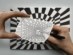 "Pencil vs. Camera Geometry (10x15 in.). Pencil vs. Camera Geometry is a part of Ben Heine's series, ""Pencil Vs Camera"" in which the artist creates 3D fantasy worlds through the combined use of meticulous graphite drawings, and beautifully captured photography. Using one of his surreal graphite drawings, Ben Heine creates an infinite world transforming a painting into a hallway, a the end being drawn by a tiny man, who is being drawn by Ben Heine."