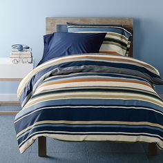 Mercer Stripe Duvet Cover Set - Patterned with variegated stripes in bold shades of sand, blue, ivory and rust, the colorful bedding is printed on smooth cotton percale.