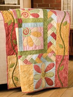 I really love quilts with designs within designs - and then the applique vines just top it off. Beautiful!.
