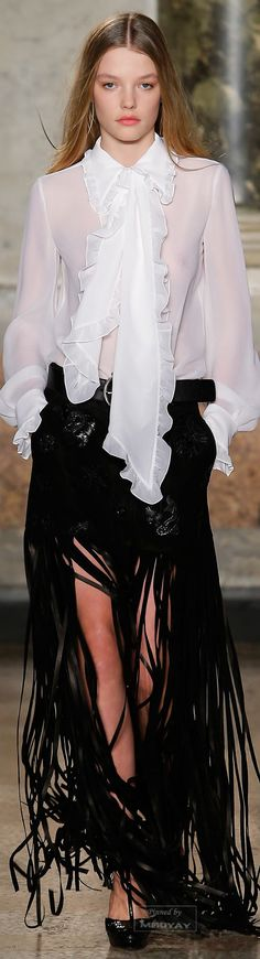 This is a dressy outfit designed by Emilio Pucci for Fall 2015 and the most prominent design feature of the outfit is the jabot which is inspired from the 1930's where the jabot was very popular for women's dress shirts and dresses. 2/20/16