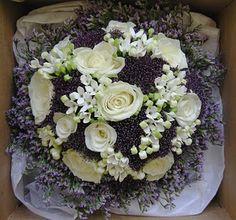 purple trachelium & white roses, surrounded with purple caspia/limonium. The white tiny flowers resemble stephanotis.