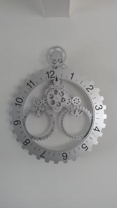 Nice clock with moving wheels that show time, date and month