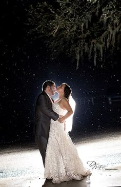 An amazing night shot with the light rain behind... it almost looks like snow. #Wedding #Couple #Romantic #night #photography #Rain #Florida #GrandOaksResort