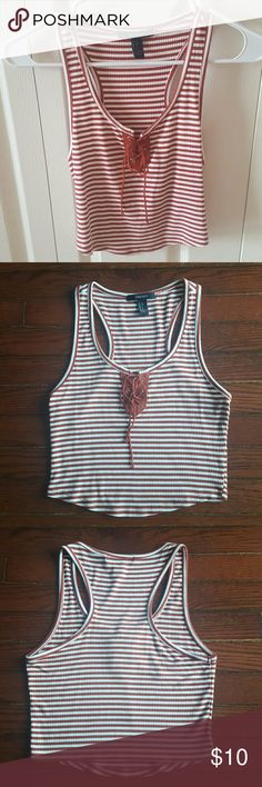 Burnt Orange Lace Up Striped Crop Top Tank Cropped tank top with burnt orange and white stripes. Laces up at the top of chest. Stretchy material. Forever 21 Tops Crop Tops