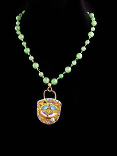 This beautiful enamel miniature gilt purse is made of gold over silver fine wide that is hand woven to form this delightful pendant. Beautiful butterflies are on both sides. The beads I think are jade and they are hand wired. I am not sure if they are original to each other. 5-3-19 Oriental, Jade Necklace, Pendant Necklace, Beautiful Butterflies, Wedding Bottles, Viking Glass, Vintage Bohemian, Hand Weaving, Miniatures
