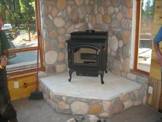 woodstove hearths | Wood Stove in rustic cabin setting