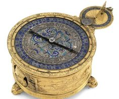 A Gilt-Brass Circular Horizantal Table Clock Case, German, Circa 1580 with Replica Movement  Sotheby's, Fine Furniture, Tapestries, Ceramics, Clocks, Silver and Carpets, London, Nov 2nd